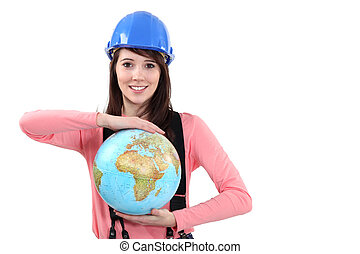 young brunette craftswoman showing globe