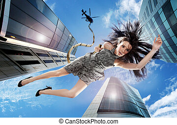 Young brunette falling down the sky