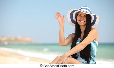 Young brunette girl on the beach in