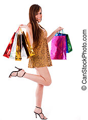Young brunette girl with her shopping bags