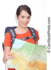Young brunette holding map