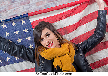 young brunette in front of american flag