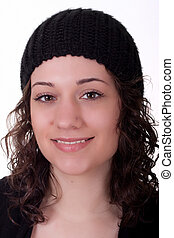 Young Brunette in Knit Cap Smiling