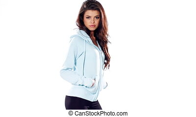 Young Brunette in Sports Clothes Posing on White Background...