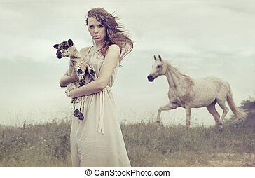 Young brunette lady holding little lamb - Young brunette...