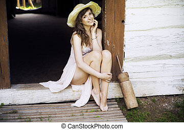 Young brunette lady in the country