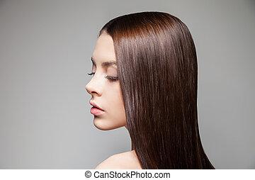 Young brunette looking over shoulder