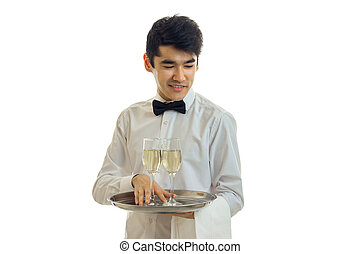 young brunette man waiter with champagne on tray smiling