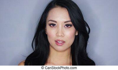 Young brunette model in studio