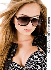 Young brunette model with sunglasses on a white background