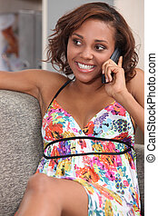 Young brunette on the phone