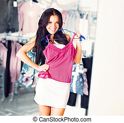 Young brunette shopping