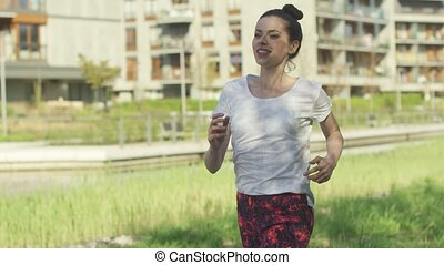 Young brunette taking morning cardio - Beautiful young woman...