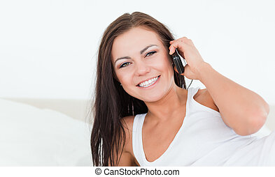 Young brunette using her phone