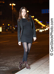 Young brunette wearing black clothes