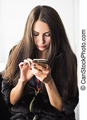 Young brunette with a phone