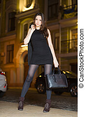 Young brunette with handbag
