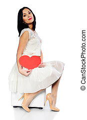 Young brunette with red Valentine heart isolated on white