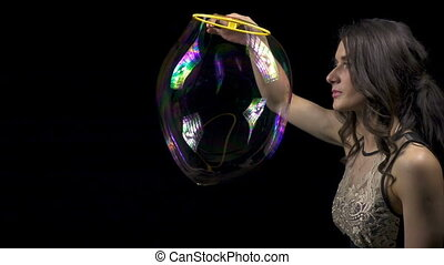Young brunette woman and soap bubbles