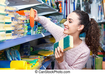 Young brunette woman choosing sponges