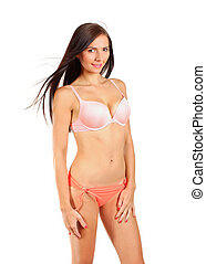 Young brunette woman in bikini underwear isolated on white background.