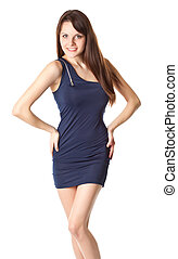 Young brunette woman in blue dress is posing