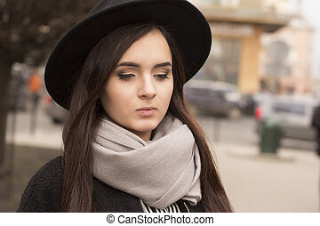 Young brunette woman in hat