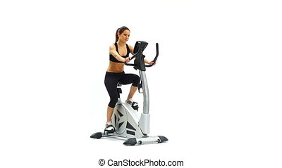 Young brunette woman on exerciser