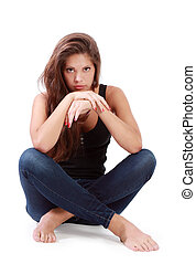 Young brunette woman sits on floor
