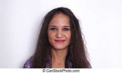 Young brunette woman smiling closeup portrait. Young...