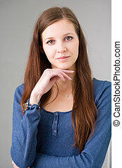 Young brunette woman thinking.