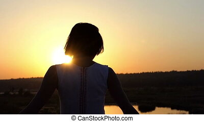 Young Brunette Woman Turns Around in a Nice Lace Dress at Sunset in Slo-Mo
