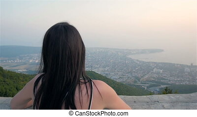 Young Brunette Woman Walking On Terrace And Enjoying Mountains View