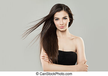 Young Brunette Woman with Brown Hair Studio Portrait