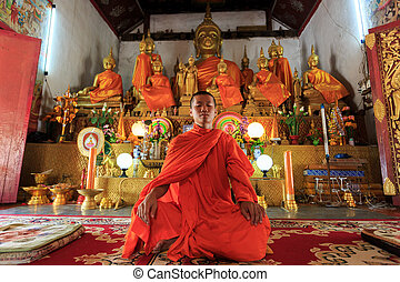 Young Buddhist Monk meditating - A monk meditating in the ...