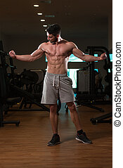 Young builder Posing In The Gym