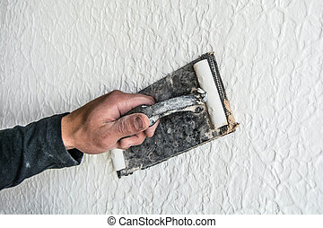 young Builder repairs in a new apartment