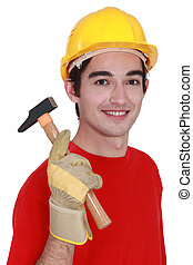 Young builder with a hammer