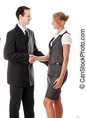 Young business couple handshaking