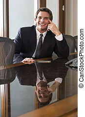 Young business executive in boardroom