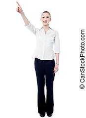 Young business executive pointing upwards