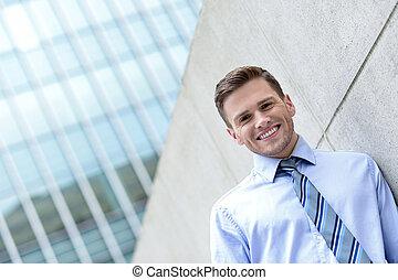 Young business executive posing outdoors