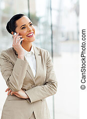 young business executive talking on cell phone