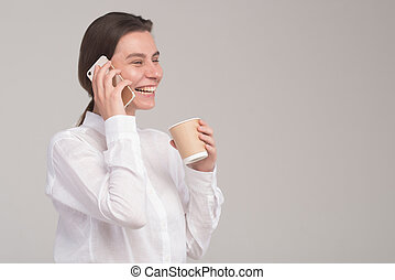 Young business girl talks on the phone isolated