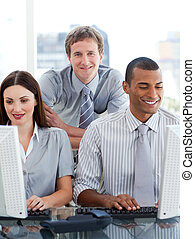Young business group working at a computer