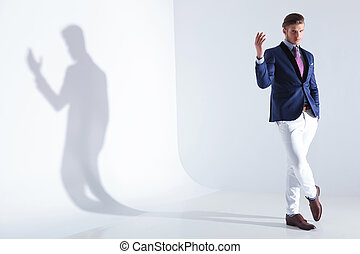 young business man along his shadow