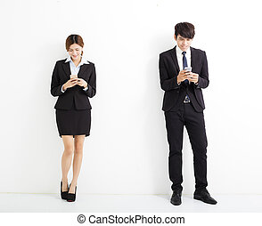 young business man and woman holding smart phone