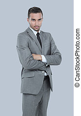 Young business man arms folded isolated on white