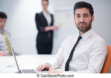 young business man at meeting - portrait of young modern ...