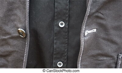 young business man buttoning his jacket. close up
